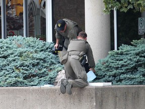 Members of the OPP explosive disposal unit prepare to recover a suspicious package. The unit was called in after Chatham-Kent police responded to a report of a suspicious package outside of the Judy LaMarsh Building in Chatham on Monday morning. Ellwood Shreve Photo/Chatham Daily News