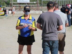 Pit gate attendant Jean Patenaude checking for wristbands and face coverings on Sunday afternoon. Photo on Sunday, June 20, 2021, in Cornwall, Ont. Todd Hambleton/Cornwall Standard-Freeholder/Postmedia Network
