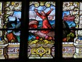Stained glass window in Gamla Stan in Stockholm, depicting Jonah and the whale, created before 1900.  Not Released