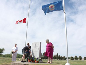 Grade 8 students from LP Miller School in Nipawin placed flags on the graves of veterans at Mabel Hill Cemetery on June 4 as part of Decoration Day observances. The day is to remember the service of military personnel in a similar manner to Remembrance Day, which honours those who died while in service. Photo Susan McNeil.