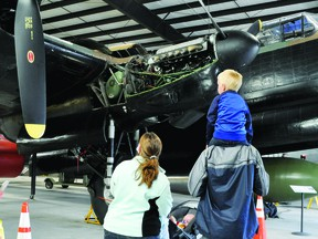 John and Katie Groenendyk took sons Willem, 3, and Wesley, 3 months, for a tour of the Bomber Command Museum of Canada on Thursday, when the musem reopened under Stage 2 of the Alberta government's Open for Summer Plan. At the museum various COVID-19 protocols are stilll in place, including the need for visitors to wear masks and travel in one direction around the hangar.