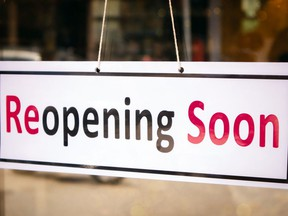 Reopening Soon Signage board in front of Businesses or Restaurant door after covid-19 or coronavirus outbreak - Concept of back to business after pandemic  Not Released (NR)