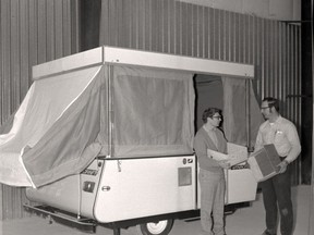 Robert Fiddler, general manager, and George Burgers, production manager, stand with the first model of a tent trailer manufactured in Listowel.  Stratford-Perth Archives
