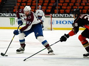 Colorado Avalanche defenceman Keaton Middleton moves the puck against Anaheim Ducks defenceman Jani Hakanpaa during the third period at Honda Center during a game in April.