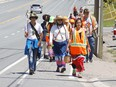 Participants take part in the Enji-TibewÕeseng Nibi Nikwejiwong, an Anishinaabe ceremonial Water Walk for Junction Creek, in Greater Sudbury, Ont. on Wednesday June 16, 2021. Water Walker and conductor of the walk, Tasha Beeds, is leading walkers on a 135 kilometre journey to Spanish where a private ceremony will be held. Participants, who are walking for the water, began their journey in Garson. John Lappa/Sudbury Star/Postmedia Network