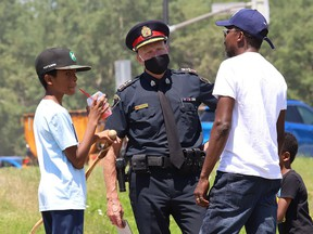 Greater Sudbury Police Chief Paul Pedersen, middle, attended the Black Lives Matter: Juneteenth Racial Injustice Rally at Bell Park last year.