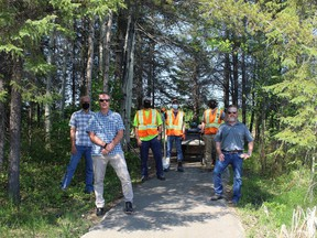 Representatives from Lake Shore Gold Corp., Wintergreen Fund for Conservation and Mattagami Region Conservation Authority checking on work being completed along the Golden Springs recreational trail. From left, Kees Pols, Wintergreen director, Dave Vallier, MRCA manager, Kevin Gagnon, MRCA field supervisor, Branden Dubosq, student, Brad Bonsall, student, Marcel Cardinal, director of environmental and sustainability with Lake Shore Gold.  Supplied
