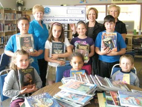 CLUB DONATION-Ten years ago, the Richelieu Club donated $1,250 to École catholique Nouveau Regard to help purchase books for the school library. The books vary from those for early readers to those for advanced ones, which complements the reading program already in place at the school, and helps students move up reading levels more easily. Pictured in back (from left) are Richelieu Club president Lucille Narbonne, Principal Laplante-Hardy, and Richelieu Club member Diane Ayotte; and in front (from left) Arianne Génier, Noëlla Ilunga, Réjean Ouellet, Dominic Beaudoin, Danika Beaulne, Sabrina Mercier and Casey Groulx.  .TP.jpg