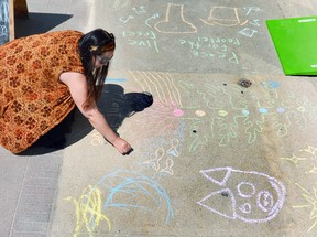 Local artist Jennifer Hicks works on a chalk art mural on the sidewalk in front of the Grey Gallery on 2nd Avenue East in Owen Sound in 2019. Denis Langlois/The Owen Sound Sun Times/File photo