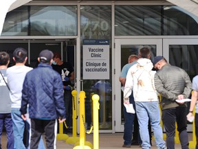 People queue outside the COVID-19 vaccination site on Leila Avenue in Winnipeg on Wednesday, May 12, 2021.