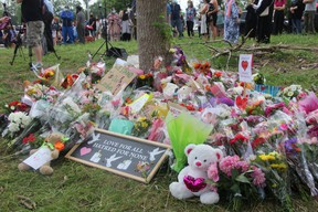 An impromptu memorial was created at the corner of Hyde Park and South Carriage roads in honour of the four members of a Muslim family killed June 6 in what London police allege was a racially motivated attack. (JONATHAN JUHA/The London Free Press)