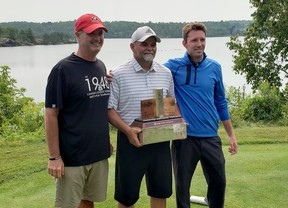 Idylwylde Men's Invitational winner Don Martone poses for a photo between tournament chair Robbie Coe, left, and Idylwylde Golf and Country Club pro David Bower in Sudbury, Ontario on Monday, July 26, 2021. Randy Pascal/For The Sudbury Star