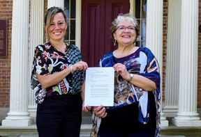 Norfolk Mayor Kristal Chopp, left, and Brendalee Engelhardt, chair of the Lynnwood Arts Centre board of directors, gathered at the arts centre in downtown Simcoe last week to mark an agreement for the eventual re-opening of the facility in early-2022. – Norfolk County photo
