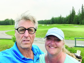 Doug McCarthy, seen here with his wife, is ready to step behind the bench for the Devon Barons next season. (Supplied by Doug McCarthy)