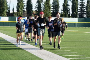 Members of the Spruce Grove and District Minor Football Association (SGDMFA) Bantam team hit the field at Fuhr Sports Park on Thursday, Jul. 22, 2021, for agility practice camp. Photo by Kristine Jean/Postmedia Network.