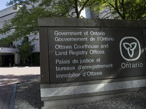 A file photo of signage near the courthouse on Elgin Street in Ottawa.