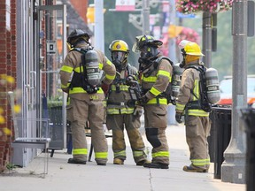 Chatham-Kent firefighters enter a business on Erie Street North while investigating a potential gas leak in downtown Wheatley, Ont., on Monday, July 19, 2021. Mark Malone/Chatham Daily News/Postmedia Network