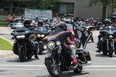 A convoy of motorcycles leaves Elgin-Middlesex Detention Centre, where nearly 1,000 people gathered to protest the death of inmates Saturday, July 17, after the funeral of Brandon Marchant, the latest inmate to die at the London jail. (Dale Carruthers/The London Free Press)