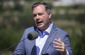 Alberta Premier Jason Kenney speaks about the Open for Summer Plan and next steps in the COVID-19 vaccine rollout, in Edmonton, Friday, June 18, 2021. Changes are coming to Alberta's cabinet, Kenneyslated to announce a shuffle Thursday morning.