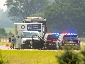 """Police closed a section of Highway 401 east of Chatham while the province's Special Investigations Unit probes the death of a man following an encounter with an OPP officer early Wednesday. Chatham-Kent OPP, responding to a gas theft, followed a vehicle that rolled into a ditch. """"An interaction took place with a male occupant and the officer discharged his pistol,"""" the SIU said. Mike Hensen/The London Free Press"""