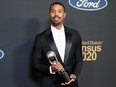 """MIchael B. Jordan poses backstage with his trophy for Outstanding Actor in a Motion Picture for """"Just Mercy"""" at the NAACP Image Awards in Pasadena, California."""