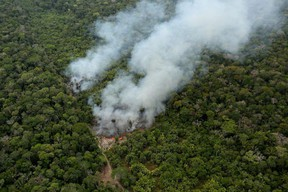 FILE PHOTO: An aerial view shows a fire in an area of the Amazon rainforest near Porto Velho, Rondonia State, Brazil, September 10, 2019. REUTERS/Bruno Kelly TPX IMAGES OF THE DAY/File Photo ORG XMIT: FW1