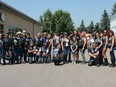 Members of Against All Abuse and Airdrie POWER gather for a group photo to celebrate the successful fundraiser at East Coast Pub and Eatery on July 17.