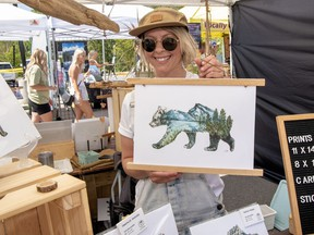 Nikki Goodwin sells her art at the Mountain Market at Elevation Place on July 1. photo by Pam Doyle/www.pamdoylephoto.com