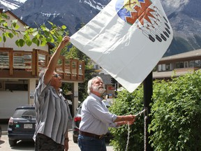 Canmore Mayor John Borrowman, and the late Tribal Historian, Buddy Wesley, from Stony Nakoda, raised the Treaty 7 flag outside the Civic Center in Canmore to celebrate unique heritage and diverse cultures of the nation's aboriginal peoples on June 21, 2020.Photo Marie Conboy/ Postmedia.