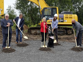 Humane Society chair Donna Endicott, centre, tries to keep canine ambassador Millie in line during a groundbreaking ceremony Friday at the site of the society's future home at 34 Wallbridge-Loyalist Road in Belleville. With them from left were Quinte West Mayor Jim Harrison, society capital campaign chair Greg Sudds, Taskforce Engineering president Hilary Murphy, and Belleville Mayor Mitch Panciuk.