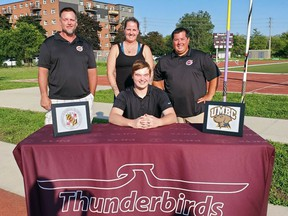 Pauline Johnson Collegiate graduate Toren Burr has accepted a scholarship to attend NCAA Division I University of Maryland, Baltimore County, where he'll throw javelin for the school's track and field team. With Burr are coaches Trevor Windle (left), Vicki Webb and Sean Doucette.
