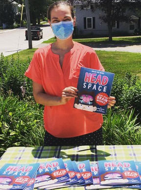 Jennifer Misener holds her book, Head Space, at The Village Store in Athens. Head Space follows main character Brian the Brain as he goes through his day. The book allows children to explore and learn about their own brains. Submitted photo/The Recorder and Times