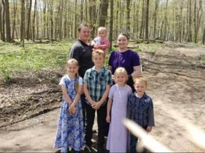 Jake and Tina Hiebert are pictured with their five children. The parents and three of the kids were badly hurt in a firepit mishap at a relative's home in Port Burwell. (Submitted)
