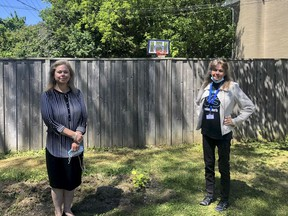 Catherine Oxford and Ruth Woodman stand outside one of of the Kingston Youth ShelterÕs Youth Transition Homes in June 2021. Brigid Goulem/The Kingston Whig-Standard/Postmedia Network