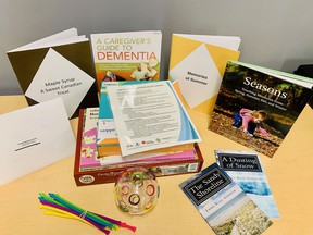 Contents of one of the Reminiscing Kits available for loan at Kingston Frontenac Public Library. The kits contain materials that are designed to facilitate meaningful interaction between people living with dementia and their loved ones.