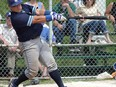 Toronto Maple Leafs catcher Damon Topolie connects for a solo home run against the Barrie Baycats at Christie Pits in this file photo.
