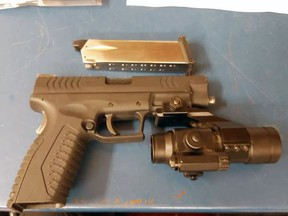 A 37-year-old Sarnia man is facing multiple charges after police say they found a replica handgun in a suspect's waistband in a local motel room on Sunday, July 25, 2021. (Sarnia police)