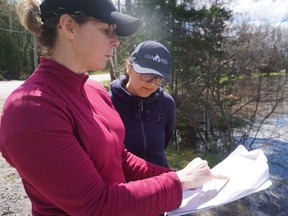 Dr. April James (left) talks to Arghavan Tafvizi, a PhD candidate at Laurentian University's Living with Lakes Centre who is creating a computer model of northeastern Ontario's water systems that can be used to predict the impact of climate change. Supplied