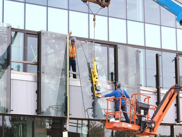Glass panels were being installed at Place des Arts in downtown Sudbury, Ont. on Tuesday July 27, 2021. The northbound curb lane on Elgin Street between Medina Lane and Larch Street will be closed from 7 a.m. to 5 p.m. until July 29, 2021 while the work is completed. John Lappa/Sudbury Star/Postmedia Network
