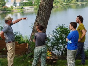 Brad Bowman, a senior environmental scientist, outlines the Minnow Lake project with team members from the Junction Creek Stewardship Group. The project is funded by the City of Greater Sudbury and the Minnow Lake Restoration Group. Supplied