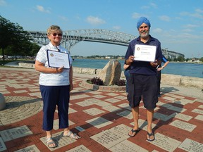 Marion Blonde (left) and Manjit Singh (right) were the 2021 recipients of the Paul Harris Fellowship, an award recognizing their significant impact in the community, given to them by the Rotary Club of Bluewaterland on July 28. Carl Hnatyshyn/Sarnia This Week