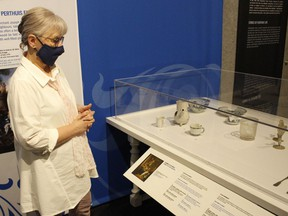Karen Bachmann, director/curator of the Timmins Museum, is inviting people to visit the museum and check out the new travelling exhibit on display called Fragments of Humanity: Archaeology in Québec.  RICHA BHOSALE/The Daily Press