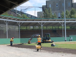 A crew is seen here working at Fred Salvador Field in Hollinger Park on Friday afternoon. Glenn Thurston, the city's manager of parks and recreation, confirmed there will be no baseball played on that field this year.  ANDREW AUTIO/The Daily Press