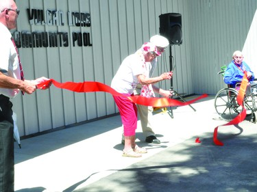 Marjorie Stephen and Gene Waskiewich cut the ribbon on Canada Day to officially open the Vulcan Lions Community Pool. Holding the ends of the ribbon are Vulcan Mayor Tom Grant and Vulcan Lion Jerry Wylie.