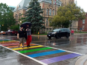 Murphy Boyse, right, a member of the local LGBT2G+ community, and Alicia Malcolm, an ally, celebrate the city's new rainbow crosswalk installed this week on Talbot Street by city hall.Eric Bunnell