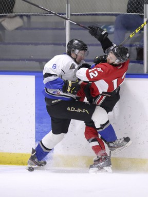 Former Thunder forward Tyler Perkins (right) collides with Lightning's DJ Kistner as the Airdrie Techmation Thunder beat the Stettler Lightning 3-1 in Heritage Junior Hockey League action at the Ron Ebbesen Arena on Friday, Jan 8, 2016 in Airdrie, Alta.