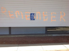 """St. Thomas' Anglican Church in Sherwood Park is one of many churches that received protest vandalism, with orange spray paint across the building saying """"REMEMBER."""""""
