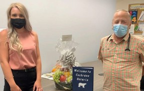 Abbigail Tremblay, the physician recruiter with Worker Bees, and Dr. McGuire pose at the Cochrane Family Health Team with a Welcome Basket donated by A&G Freshmart in Matheson. SUBMITTED PHOTO