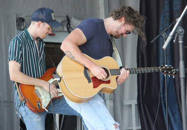 Lemon Cash's Joel Ryan (left) and Cory Papineau on stage in Pembroke on Saturday, Aug. 7.