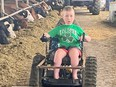 John Ray, 12, who lives with muscular dystrophy, has found independence on the farm thanks to a new track chair